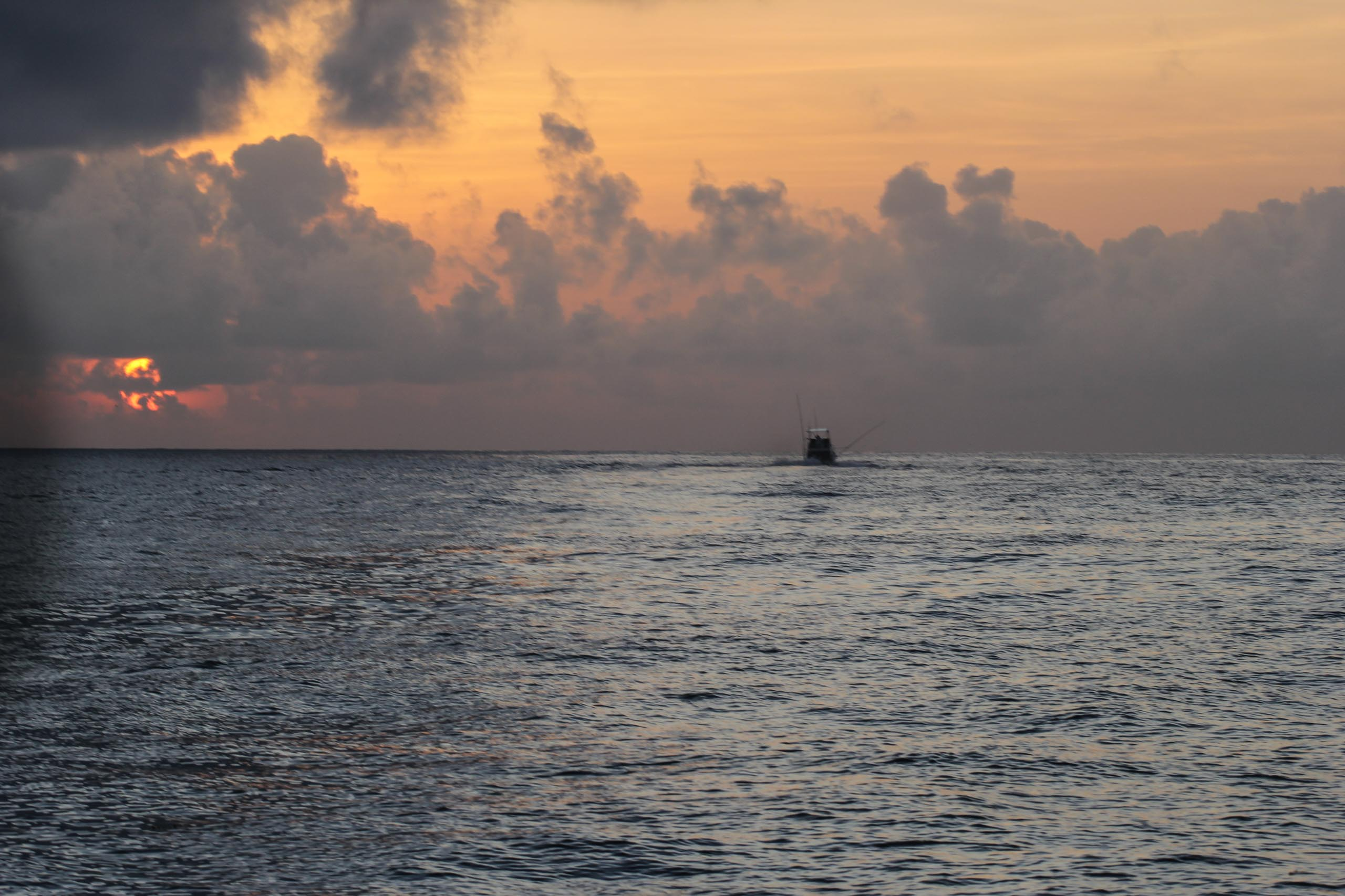 Sports fishing boat heading out from Watamu at dawn